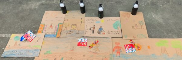 School children in Mompiche Ecuador making paintings to create awareness of the plastic problem